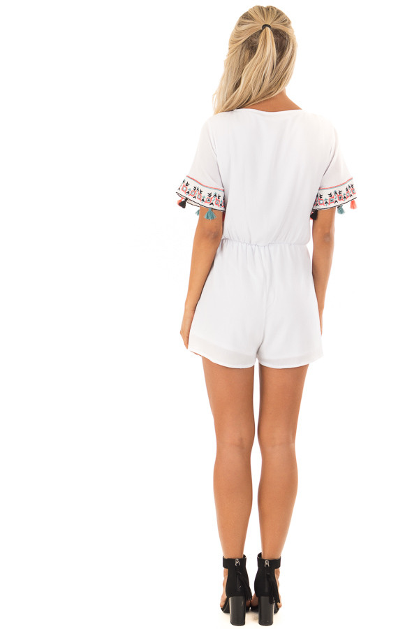 White Romper with Embroidered Trim and Multicolored Tassels back full body