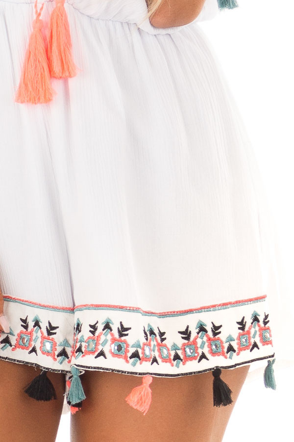 White Romper with Embroidered Trim and Multicolored Tassels detail