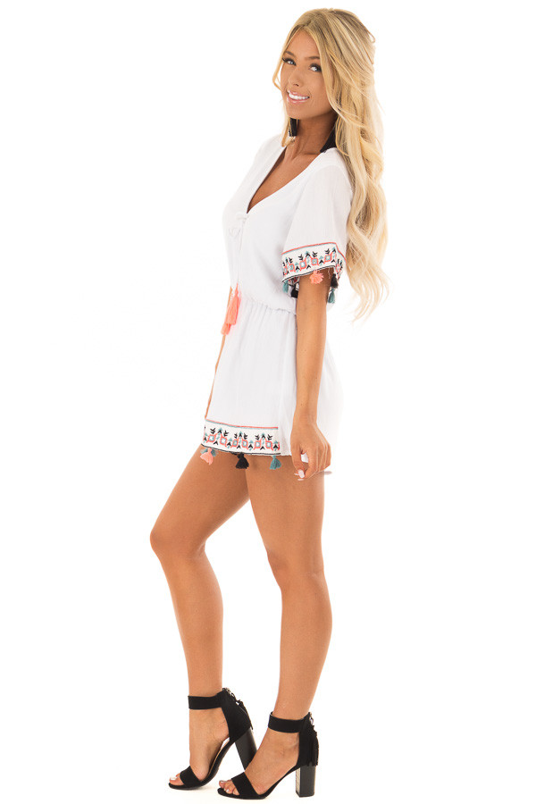 White Romper with Embroidered Trim and Multicolored Tassels side full body