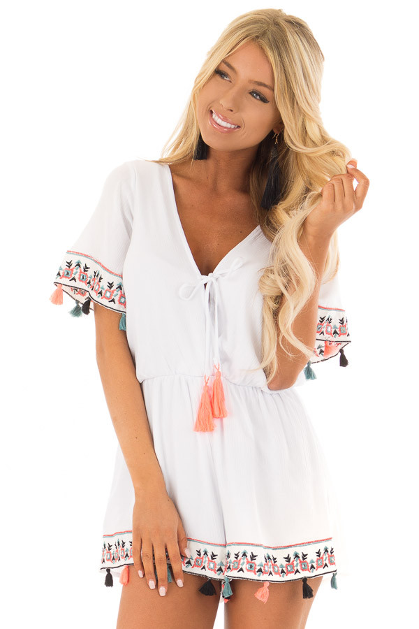 White Romper with Embroidered Trim and Multicolored Tassels front close up