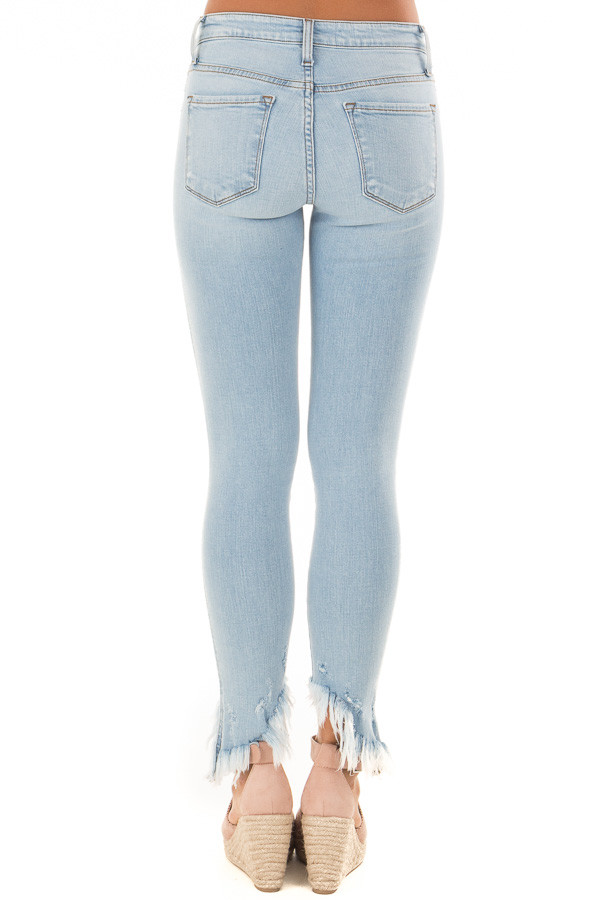 Light Wash Mid Rise Slanted Fray Skinny Jeans back view