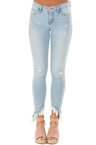Light Wash Mid Rise Slanted Fray Skinny Jeans front view