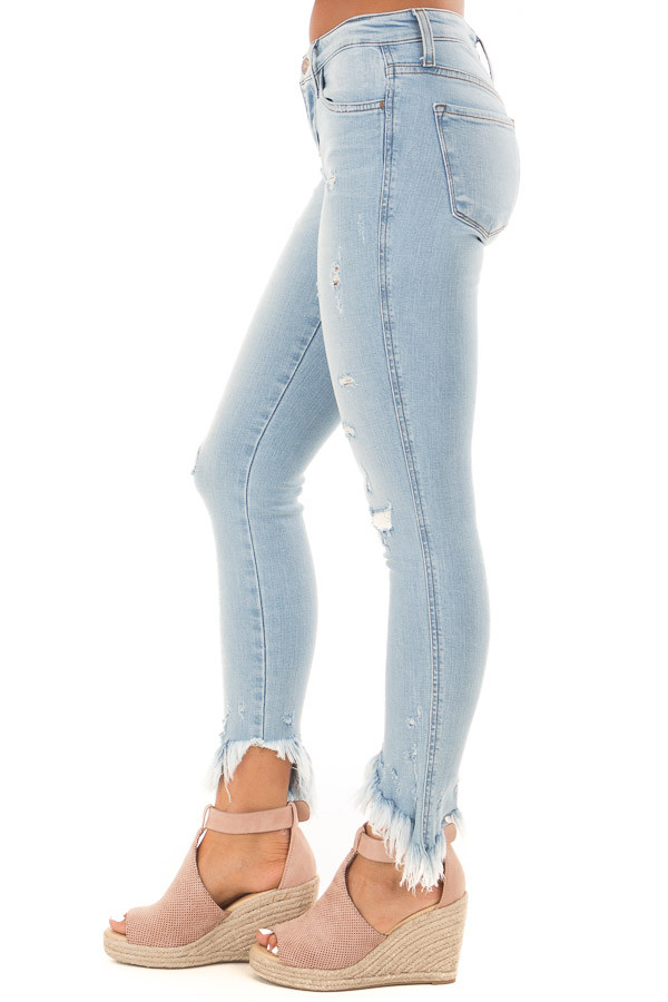 Light Wash Mid Rise Slanted Fray Skinny Jeans side view