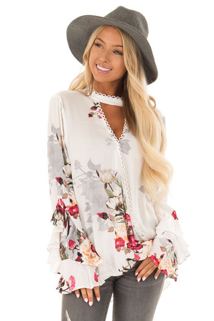 Off White Floral Print Surplice Top with Long Ruffle Sleeves front close up