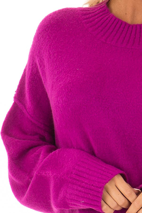 Magenta Reverse Seam Sweater with Side Slits detail