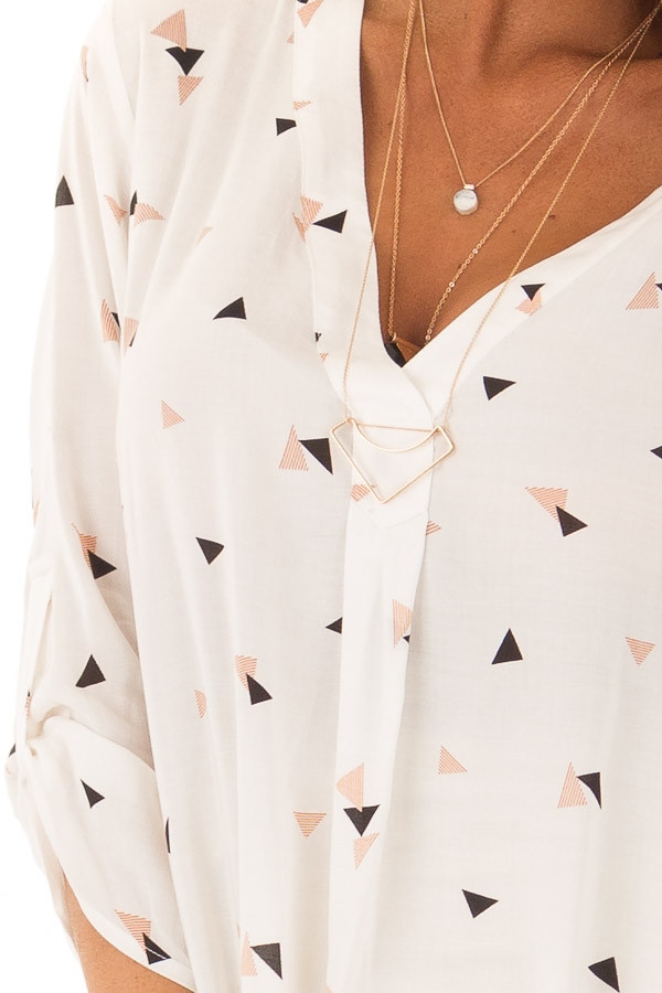 Cream Triangle Print Blouse with 3/4 Length Sleeves front detail