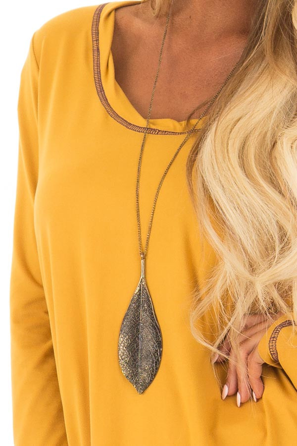 Goldenrod High Low Top with Long Sleeves and Purple Contrast front detail