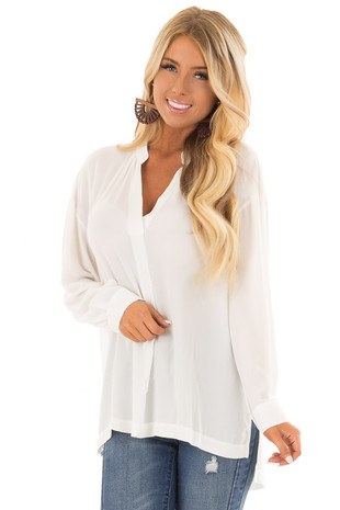 Off White V Neck Long Sleeve Blouse front close up