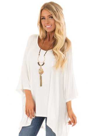 Ivory Flowy Round Neck Top with Asymmetrical Hemline front close up