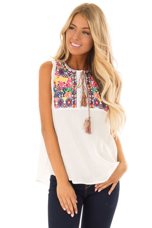 Off White Colorful Embroidered Top with Tassel Detail front close up