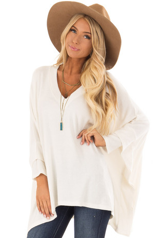 Off White Layered Poncho Style Sweater with V Neckline front close up
