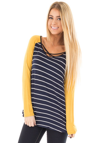 Navy Striped Top with Mustard Sleeves and Criss Cross Neckline Detail front close up