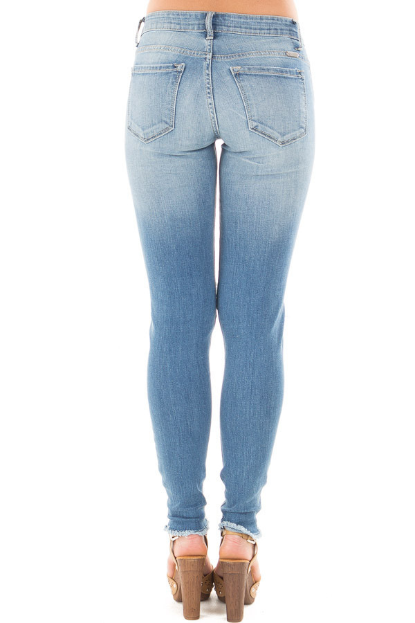 Medium Wash Skinny Jeans with Shredded Knee Detail back view