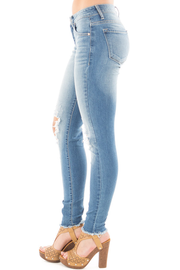 Medium Wash Skinny Jeans with Shredded Knee Detail side right leg