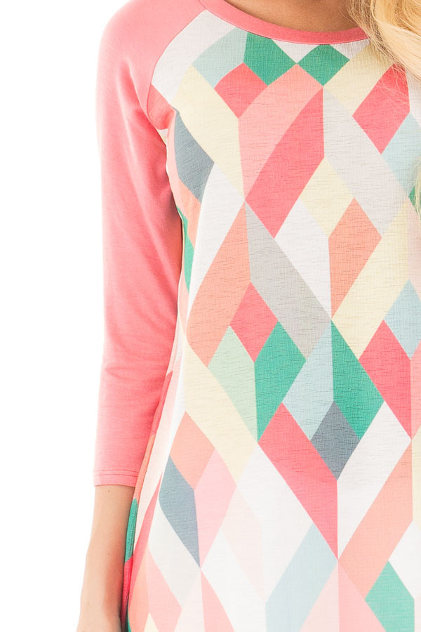 Coral Baseball Top with Multicolor Geometric Print detail