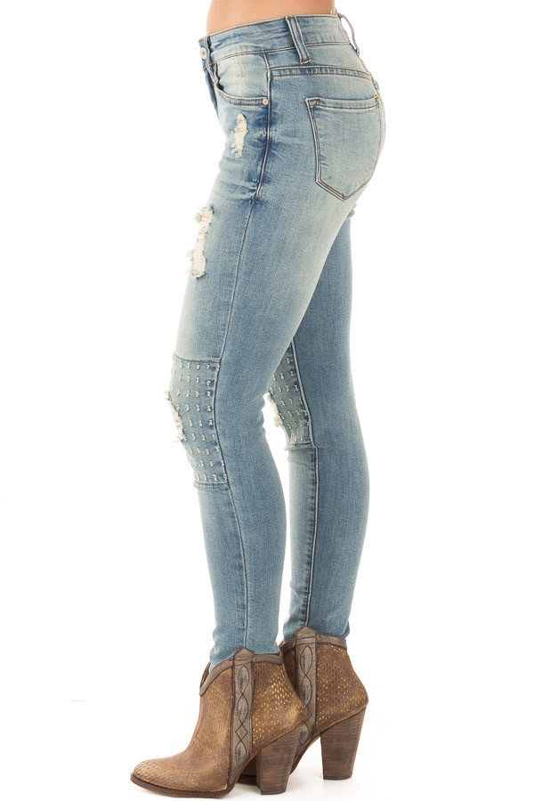 Light Wash Distressed Jeans with Stitched Knee Detail side left leg