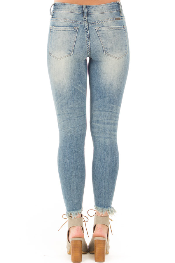 Medium Wash Destroyed Skinny Jeans with Frayed Cuffs back view