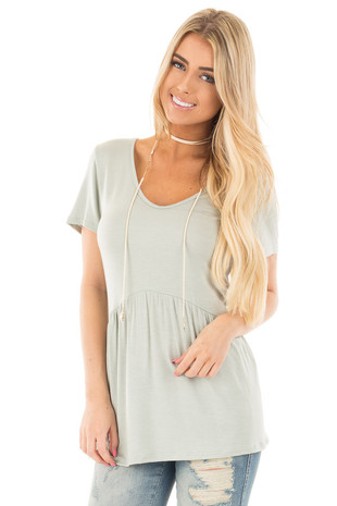 Light Sage V Neck Tee with Gathered Babydoll Waistline front close up