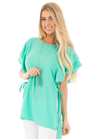 Jade Ruffle Sleeve Top with Side Slits and Tie Detail front close up