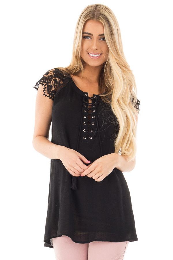 Black Woven Tunic Top with Lace Sleeves and Lace Up Front front close up