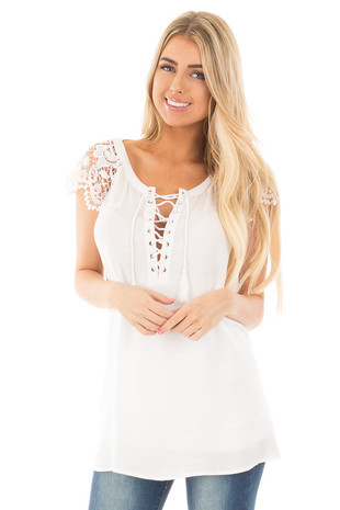 Off White Woven Tunic Top with Lace Sleeves and Lace Up Front front close up