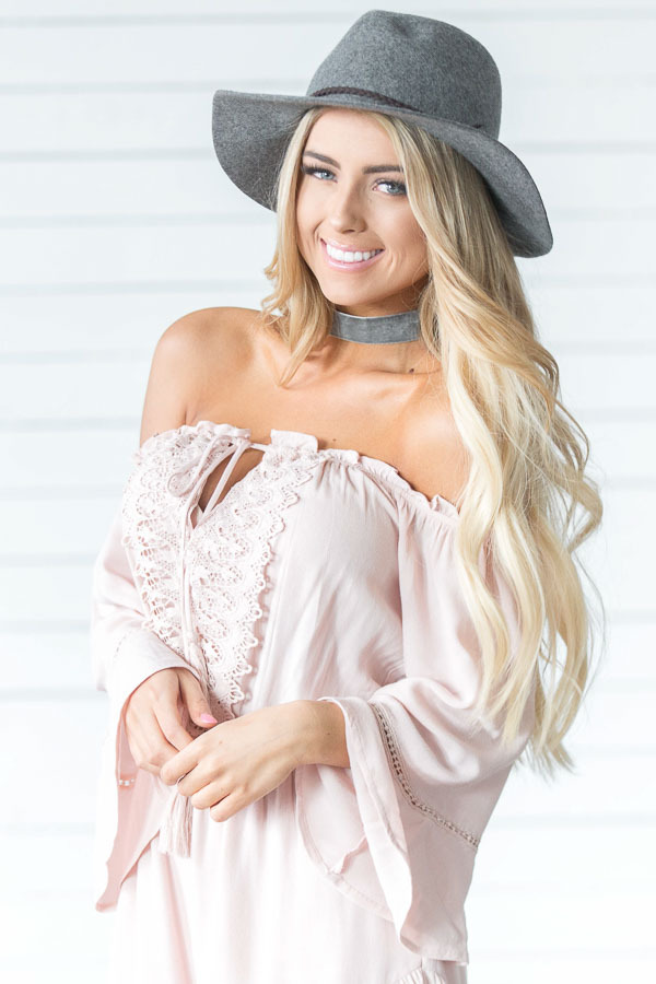 Blush Off the Shoulder Romper with Crochet and Tassel Detail front close up