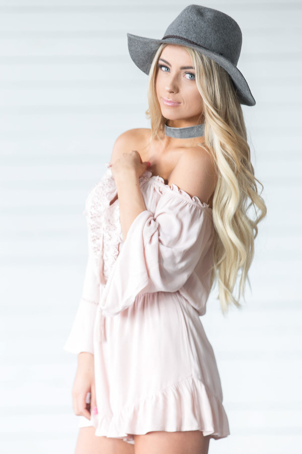 Blush Off the Shoulder Romper with Crochet and Tassel Detail side close up