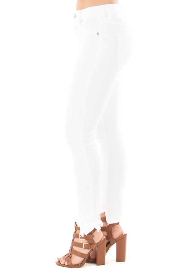 White Skinny Jeans with Seam Details and Frayed Hem side left leg
