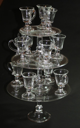 Dessert tier of three sizes of tazzas filled with jelly glasses.