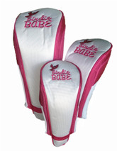 White and pink golf club head covers