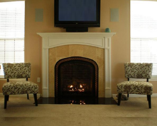 A beautiful arched custom wood fireplace mantel. The Camden.