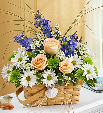Basket of roses, carnations, and snapdragons