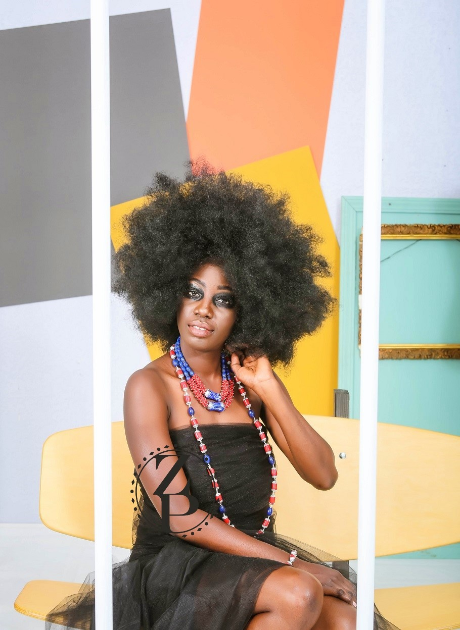 african-model-in-cage-editorial-photo-shoot-bold-eye-makeup-jewelry.jpg