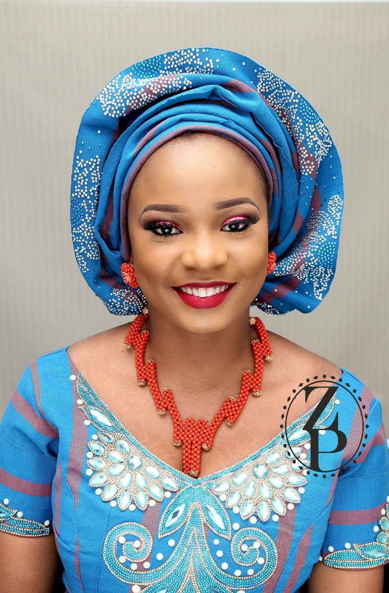 beautiful-yoruba-woman-in-blue-aso-oke-nigerian-wedding-outfit-with-orange-coral-beads.jpg