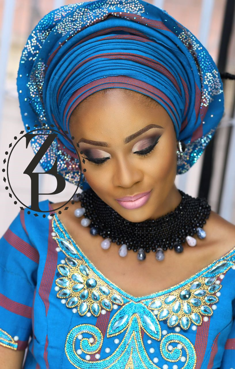 black-onyx-statement-jewelry-on-yoruba-woman-wearing-blue-aso-oke-gele-and-makeup.jpg