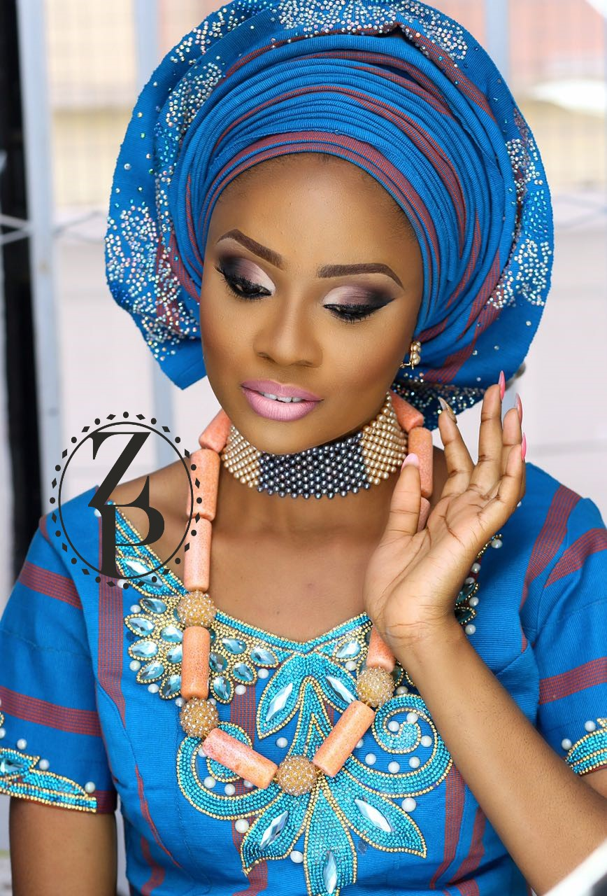 bold-blue-aso-oke-on-yoruba-bride-nigerian-wedding-coral-beads-and-pearl-necklace-zuri-perle.jpg