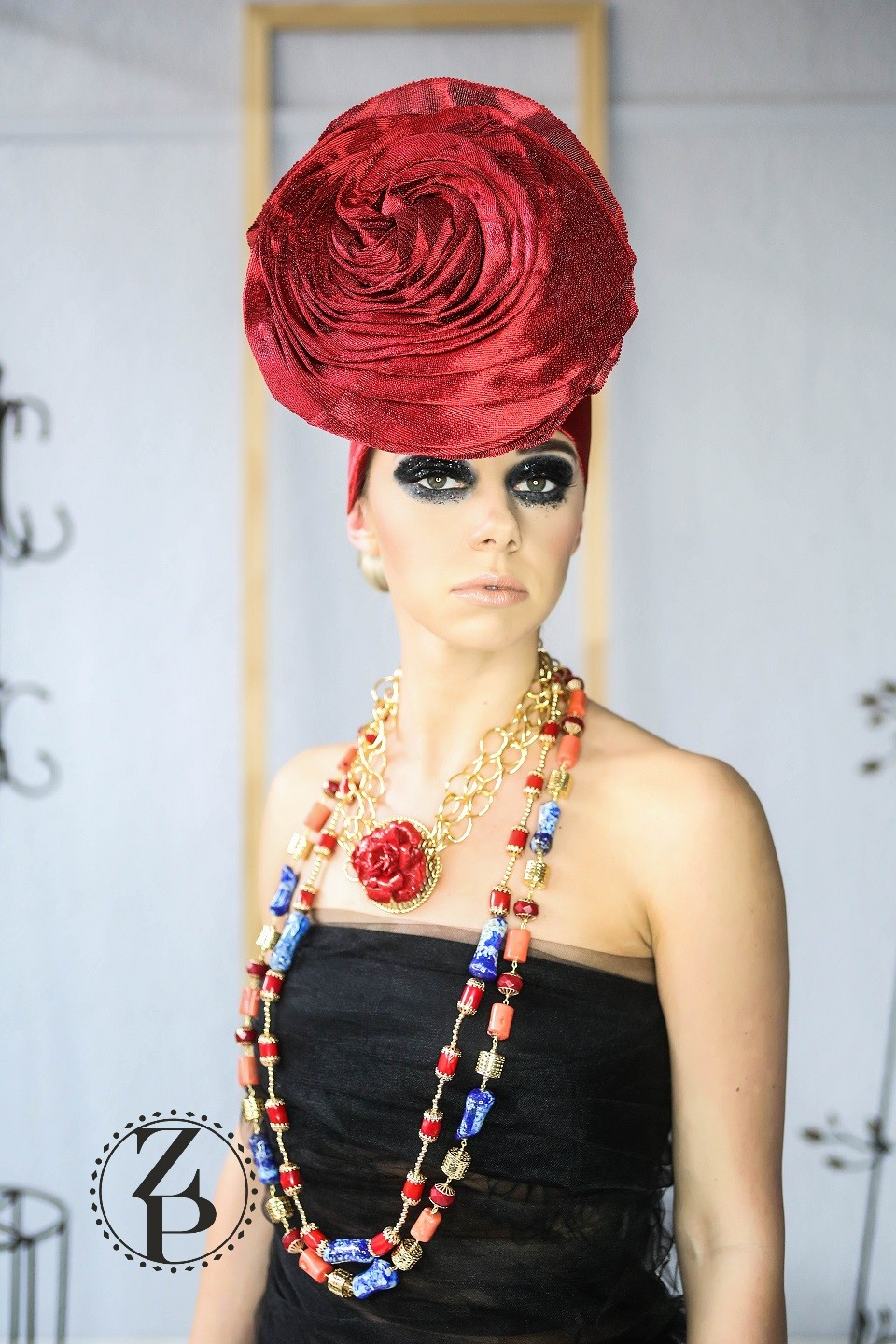 editorial-photo-shoot-bold-eye-makeup-nigerian-gele-and-coral-jewelry.jpg