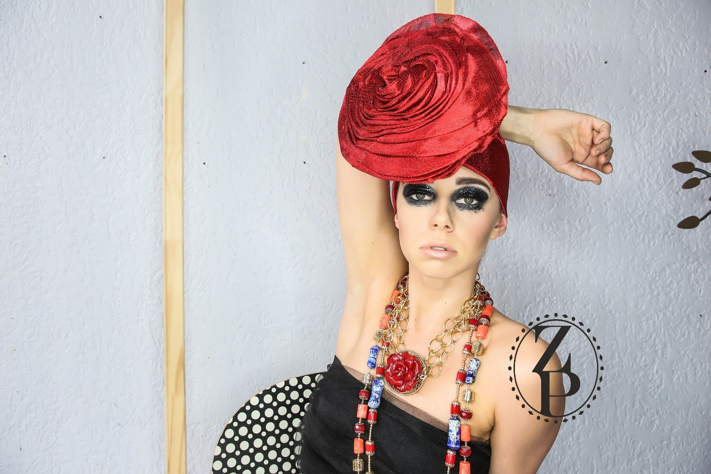 editorial-photo-shoot-bold-eye-makeup-nigerian-red-gele-and-coral-jewelry.jpg