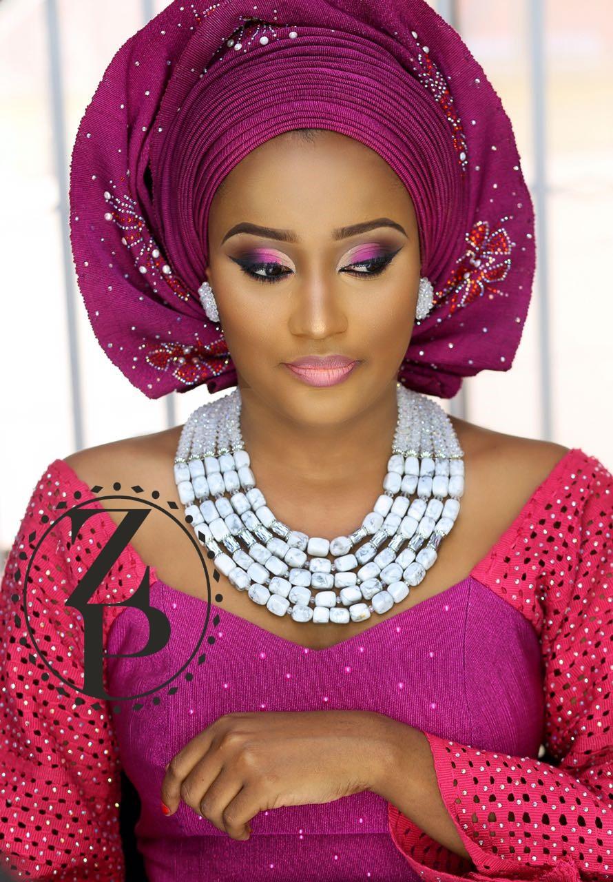 fuschia-pink-aso-oke-yoruba-bride-white-coral-jewelry-gele-makeup-nigerian-wedding-zuri-perle.jpg
