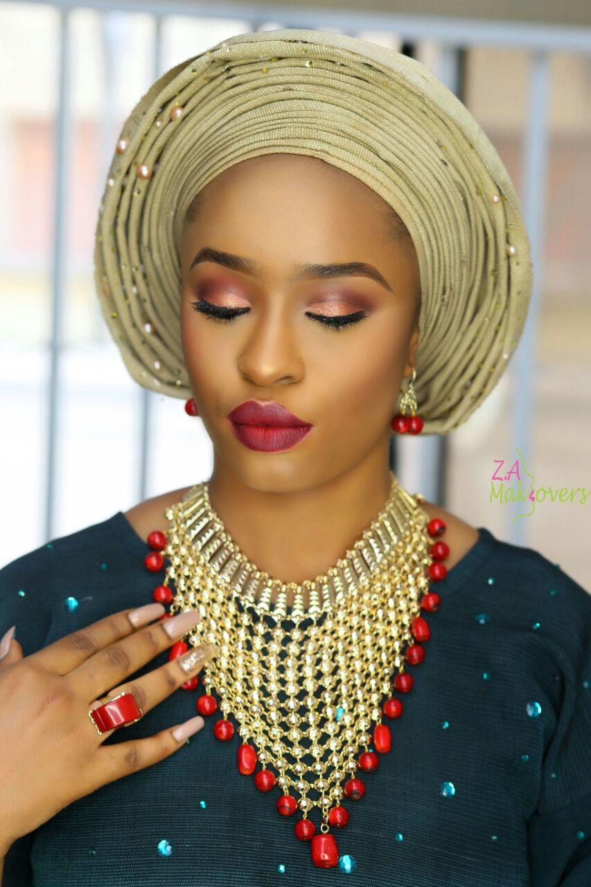 green-aso-oke-and-gold-gele-yoruba-woman-in-traditional-nigerian.jpg
