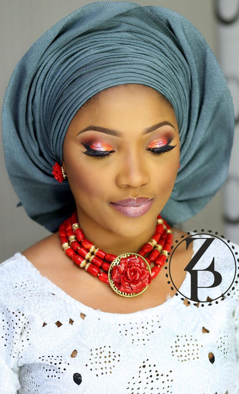nigerian-woman-in-red-coral-bead-jewelry-white-aso-oke-grey-gele-makeup-zuri-perle.jpg