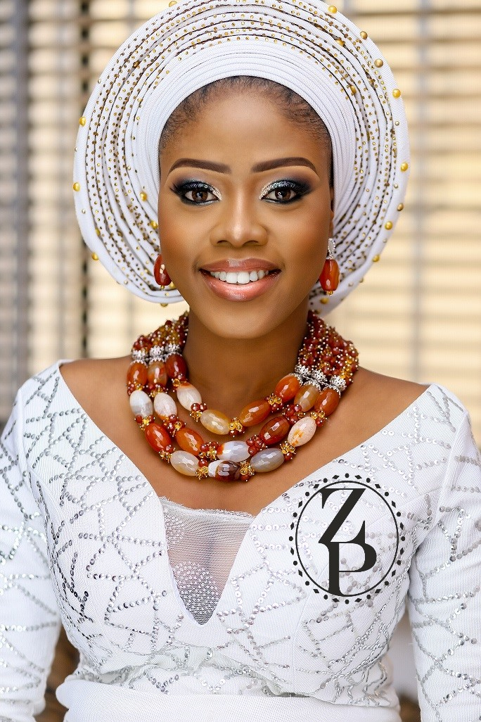 nigerian-woman-in-wedding-outfit-white-iro-and-bub-and-zuri-perle-beads.jpg