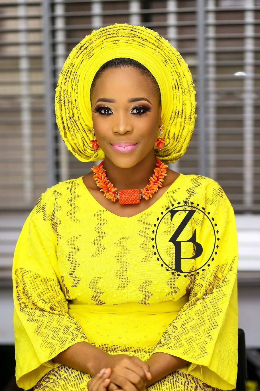 nigerian-woman-in-yoruba-yellow-iro-and-buba-orange-coral-beads.jpg