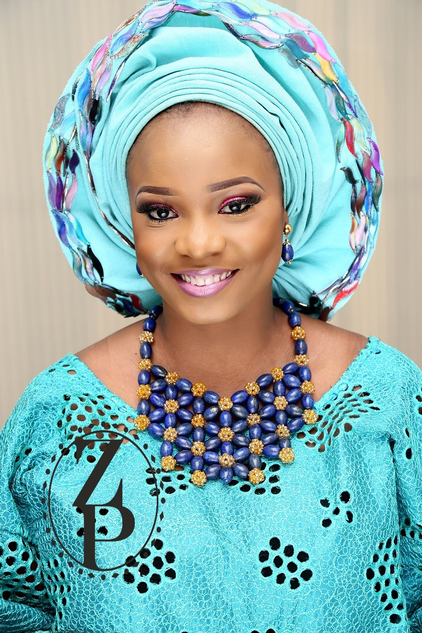 nigerian-yoruba-woman-in-teal-wedding-aso-oke-and-blue-bead-jewelry-zuri-perle.jpg
