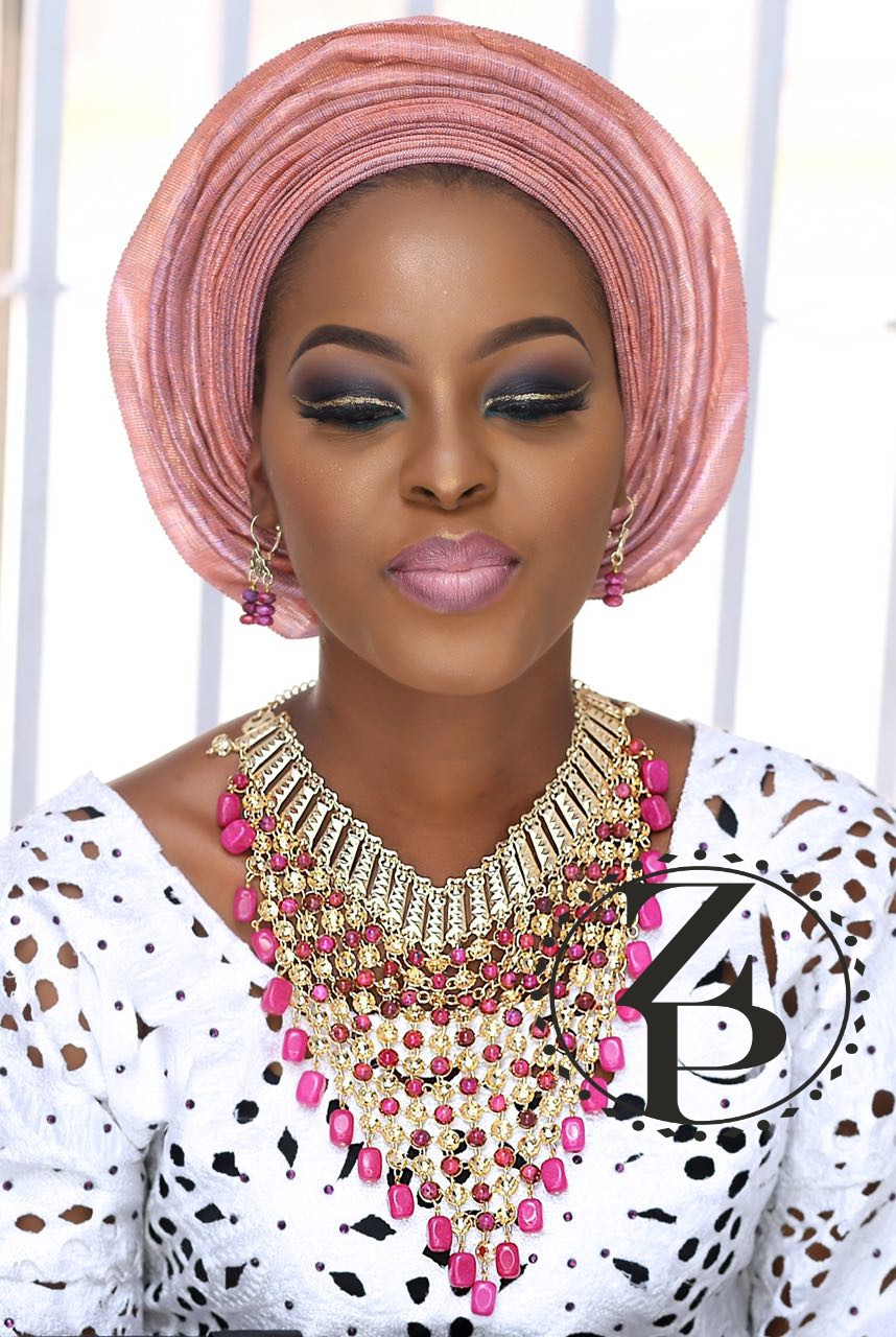 pink-aso-oke-on-yoruba-bride-nigerian-wedding-makeup-gele-jewelry.jpg