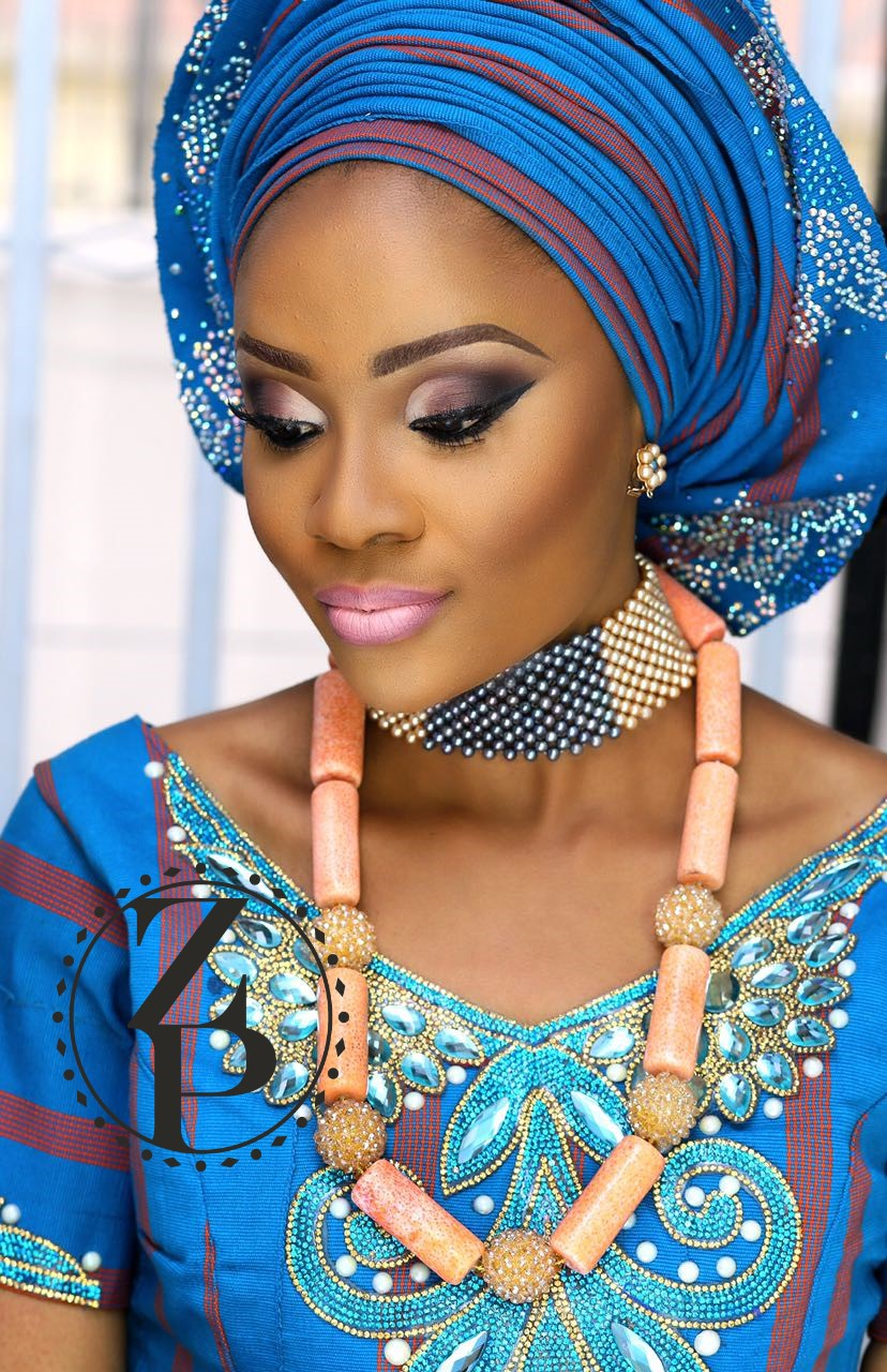 woman-in-nigerian-wedding-blue-outfit-coral-necklace-pearls-zuri-perle.jpg