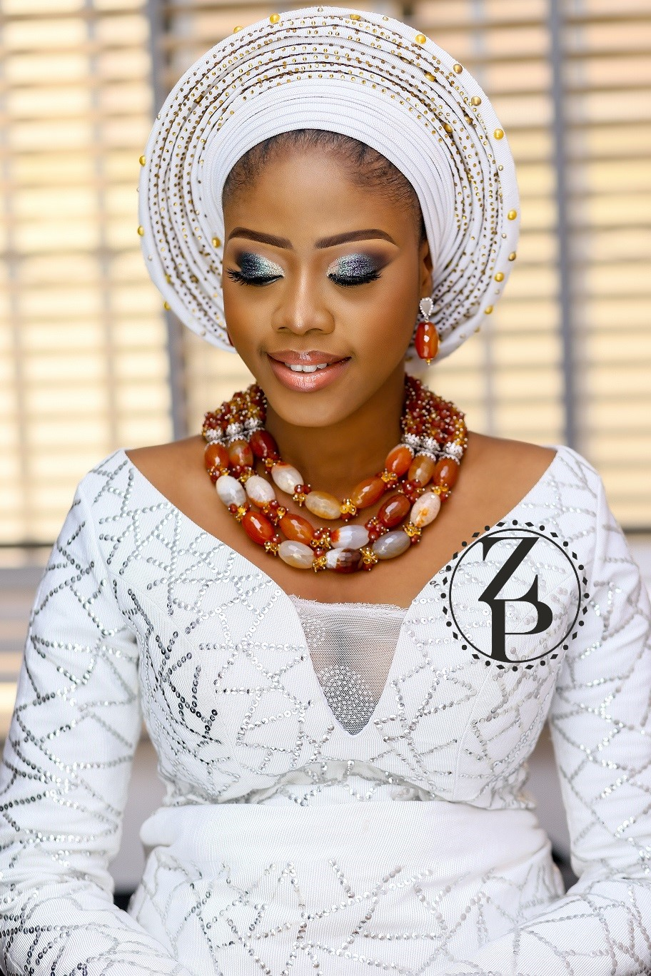 woman-in-nigerian-wedding-outfit-white-iro-and-bub-and-zuri-perle-beads.jpg