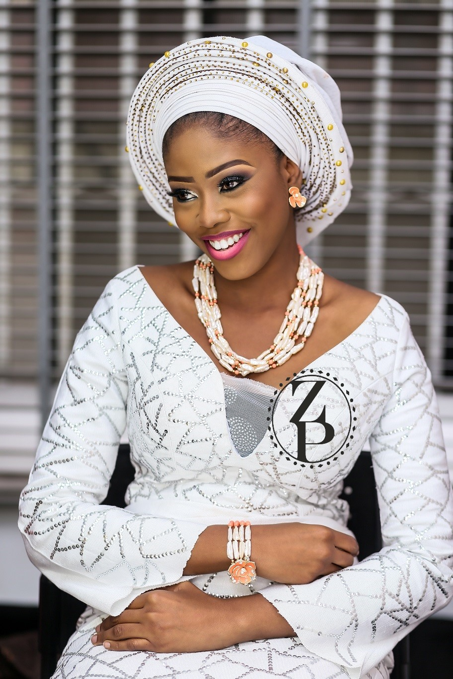 woman-in-white-iro-and-buba-yoruba-traditional-outfit-pearl-and-coral-jewelry-gele.jpg