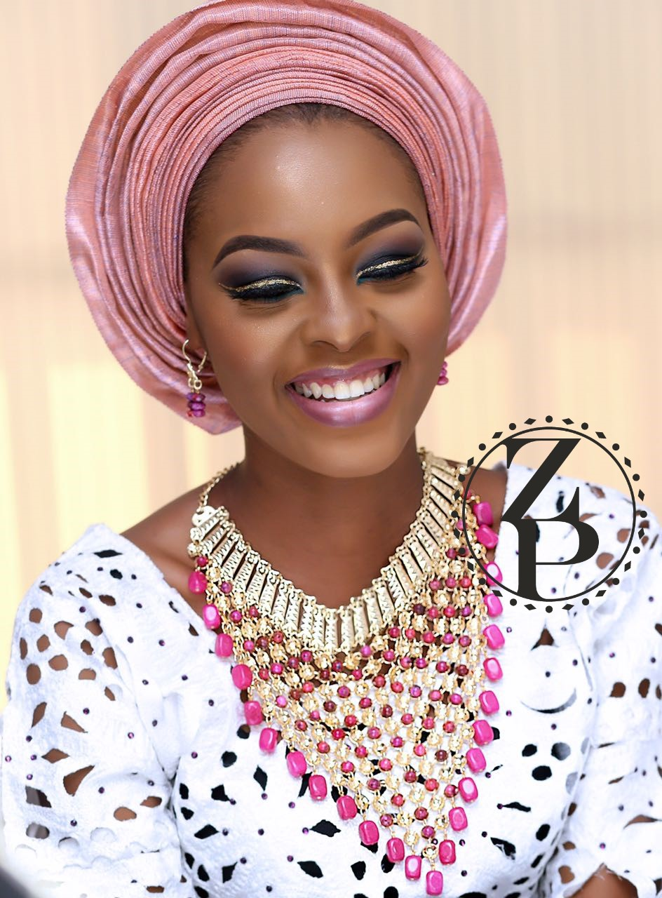 woman-nigerian-yoruba-aso-oke-traditional-pink-gele-beads-make-up-wedding.jpg