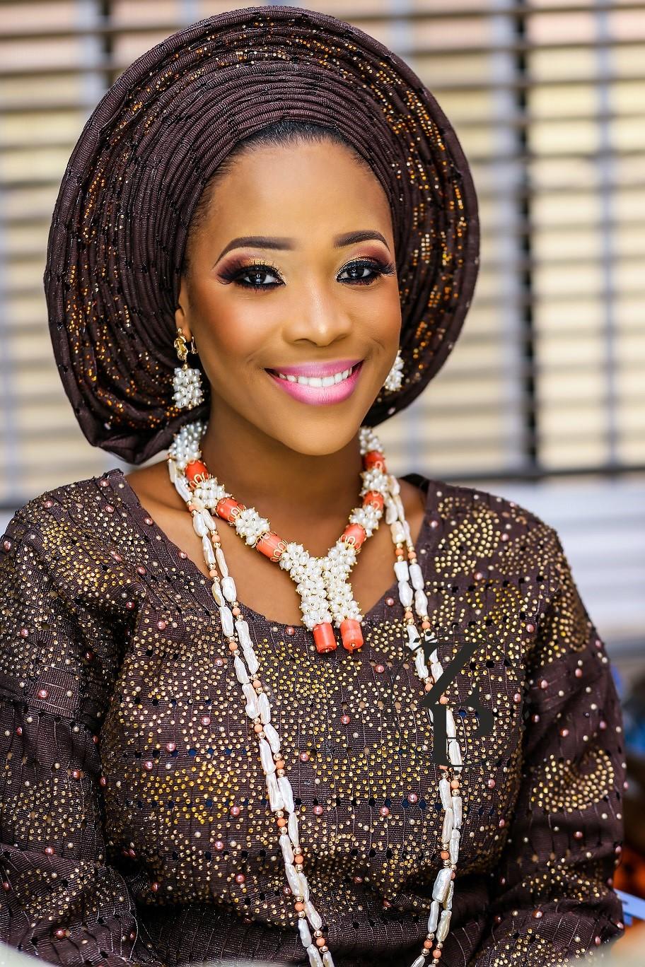 woman-yoruba-in-iro-and-buba-nigerian-traditional-outfit-pearl-and-coral-jewelry-gele.jpg
